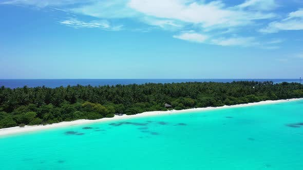 Beautiful above copy space shot of a paradise sunny white sand beach and blue sea background in colo