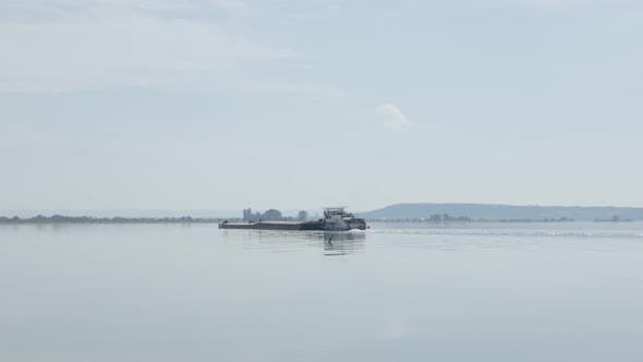 Thumbnail for River Danube border of Serbia and Romania and cargo ship 4K 2160p 30fps UltraHD tilting footage - Ba