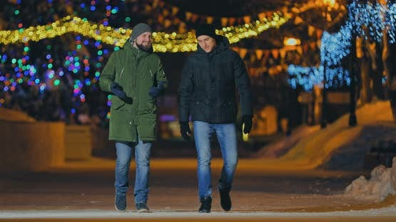 Young and Happy Men Walk in the Winter