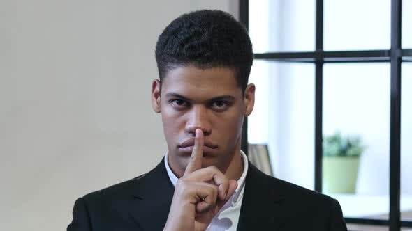 Thumbnail for Gesture of Silence by Black Businessman, Finger on Lips