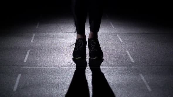 Thumbnail for Person Jumps on the Jumping Rope, Feet in Silhouette, Front View, Slow Motion