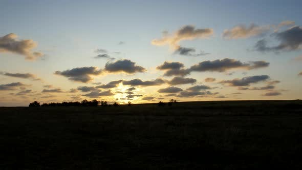 Thumbnail for Sunrise in the Steppe. The Sun Shines Through the Clouds. Cirrus Clouds Are Running