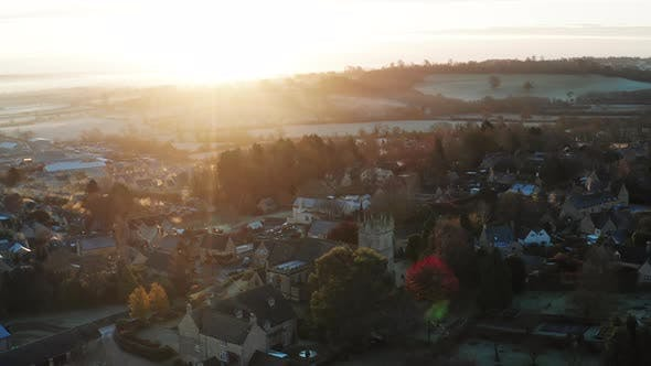 Aerial drone video of Typical English village and beautiful British countryside scenery in The Cotsw