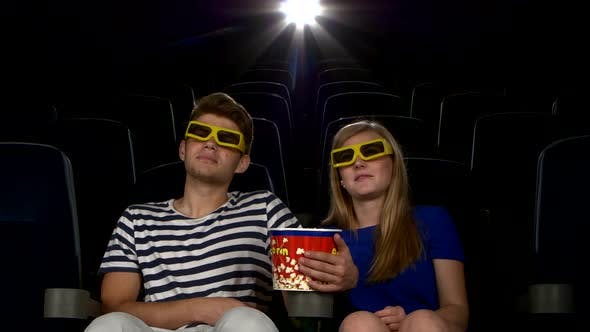 Thumbnail for Great Movie! Young Couple Feeding Each Other at the Cinema. 3D Glasses