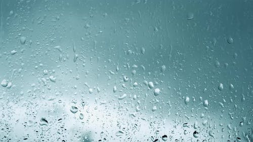 Rainy Background, Drops Flowing Down The Glass, Rain Outside The Window, Thunderstorm. Raindrops