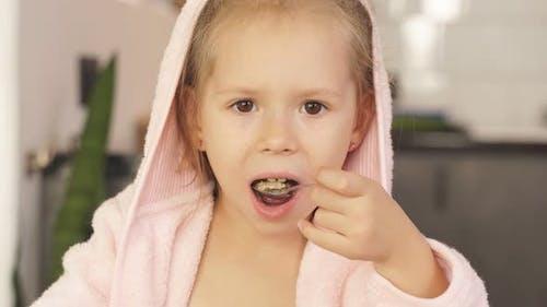 Little Girl Dressed Bathrobe Eating Oatmeal Breakfast Closeup Face