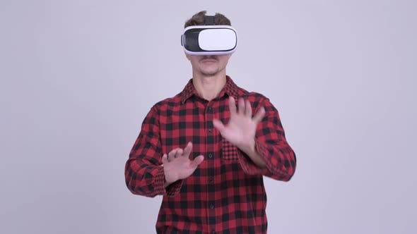 Cover Image for Hipster Man Using Virtual Reality Headset