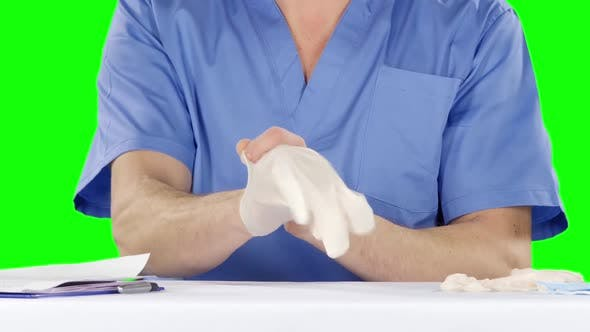 Thumbnail for Medical Doctor Putting on Gloves. Green Screen
