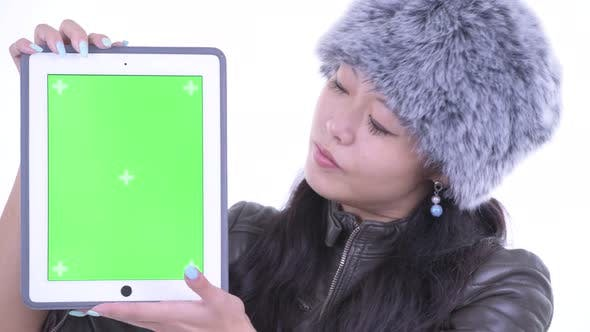 Thumbnail for Face of Happy Beautiful Asian Woman Showing Digital Tablet