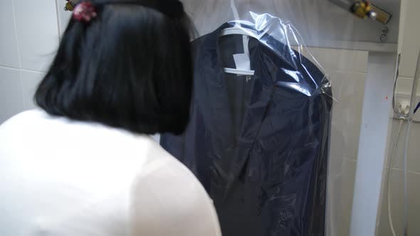 Thumbnail for Worker's Hands Putting Packaging on Cleaned Suit