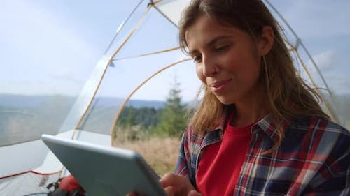 Girl Typing Message in Social Networks on Tablet