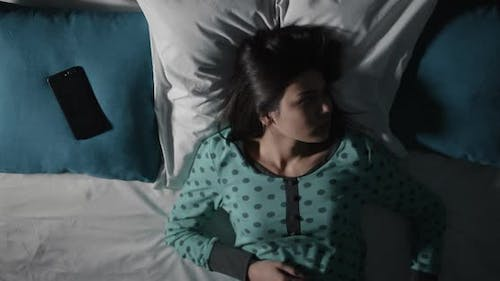 Woman Suffering Insomnia at Night Time-lapse