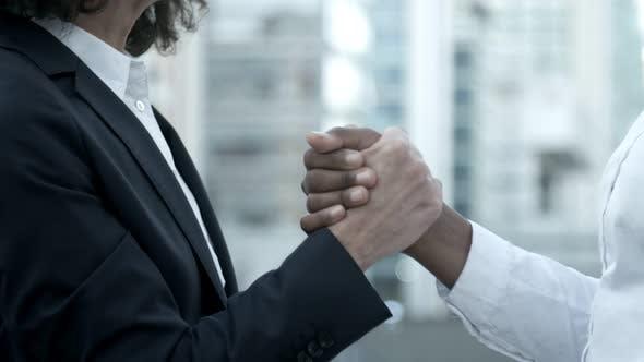 Thumbnail for Closeup Shot of Two Women Shaking Hands