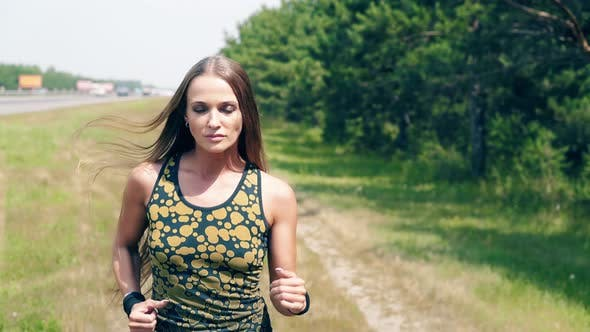 CU, Portrait: Young Girl Goes in for Sports in the Morning, Runs Along Pine Forest and Trails. Wraps