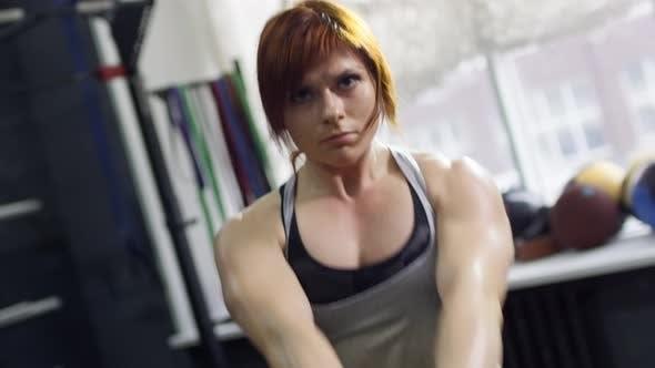 Cover Image for Muscular Sportswoman Swinging Kettlebell