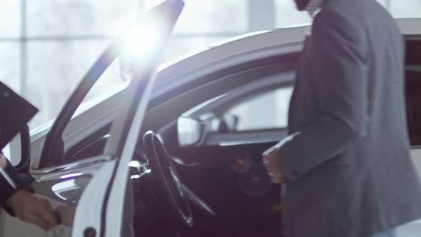 Thumbnail for Salesman Showcasing Car to Businessman