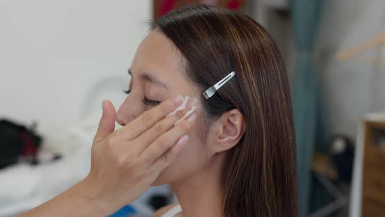 Thumbnail for Make up artist do make up on woman face in beauty salon