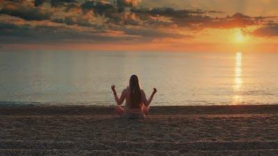 Girl Meditating on the Seashore