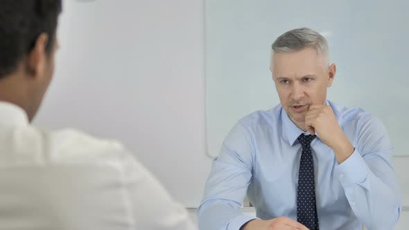 Thumbnail for Grey Hair Businessman Talking with Businessman in Office, Discussing Work