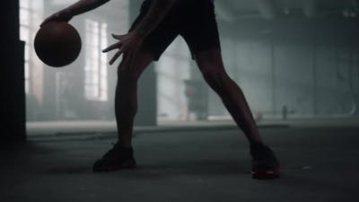 Sportsman Legs Playing Basketball