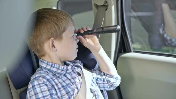 Cover Image for Kid Looking at Road with Spyglass