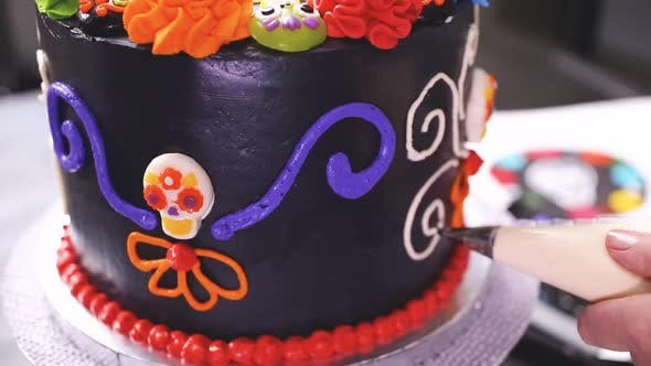 Thumbnail for Step by step. Baker decorating multilayer chocolate cake with colorful italian buttercream frosting.
