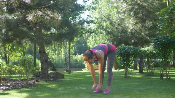 Thumbnail for Lovely Sporty Woman Stretching and Bending Forward
