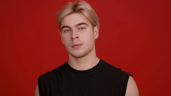 Thumbnail for Studio Portrait of Handsome Blonde Guy Looking Seriously at Camera