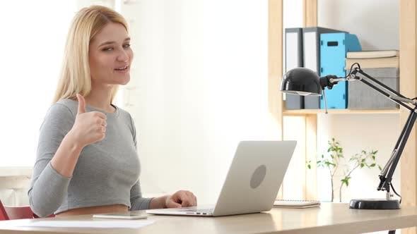 Thumbnail for Thumbs Up, Woman Gesturing while Sitting in Office