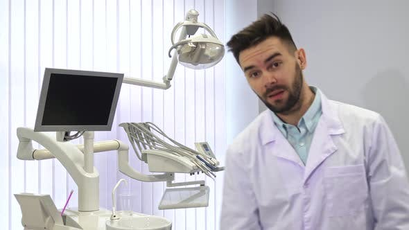 Thumbnail for Dentist Poses at the Office