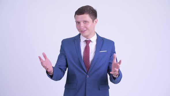 Thumbnail for Happy Young Handsome Businessman Looking Surprised