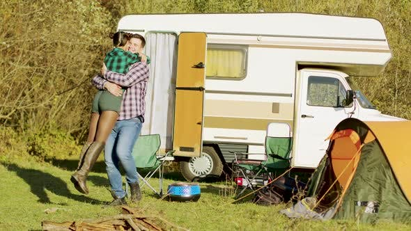 Thumbnail for Boyfriend Spinning Around Her Girlfriend in Front of Their Retro Camper Van