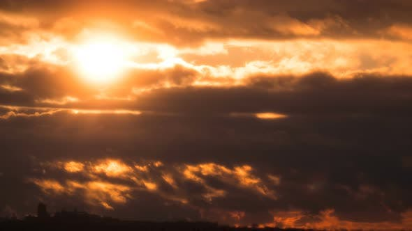 Thumbnail for Dramatic Sunset Over the Storm Clouds and Trees. Time Lapse