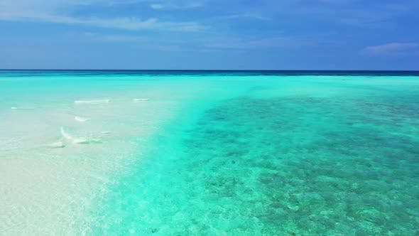 Natural flying abstract view of a sandy white paradise beach and aqua turquoise water background in