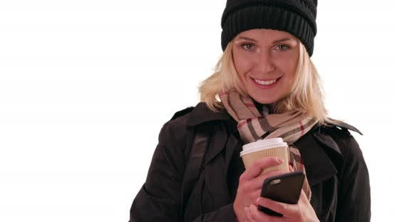 Thumbnail for Portrait of beautiful white woman dressed for winter on solid white background