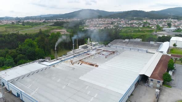 Aerial View. Chimney Pollution Pipes with Grey Smoke. Environmental Pollution Concept