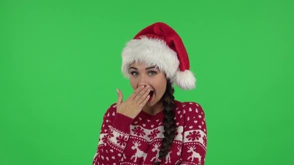 Thumbnail for Portrait of Sweety Girl in Santa Claus Hat Is Laughing While Looking at Camera. Green Screen