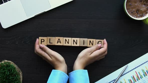 Thumbnail for Planning, Female Hand Putting Cubes With Words on Table, Business Development