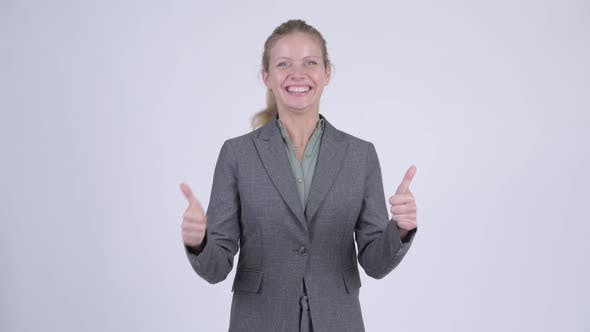 Thumbnail for Young Happy Blonde Businesswoman Looking Excited and Giving Thumbs Up