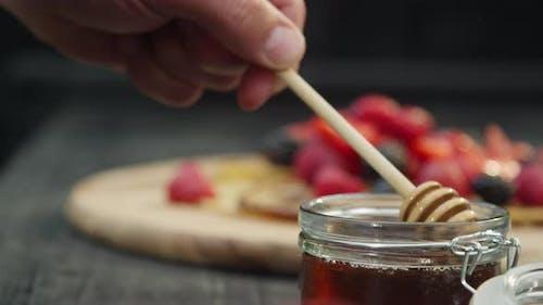 Dipper in Jar of Honey