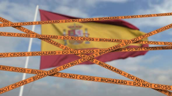 Caution Biohazard Tape at Flag of Spain