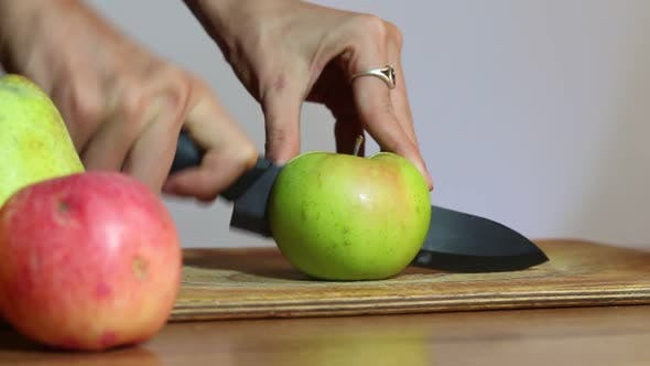 Thumbnail for Woman Cuts The Apple In Half