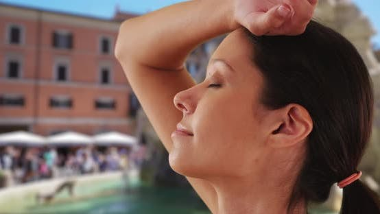 Thumbnail for Joyful female standing by Fiumi Fountain with eyes closed enjoying Rome vacation