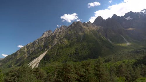 View of the Rocky High Mountains. Panorama From Right To Left.