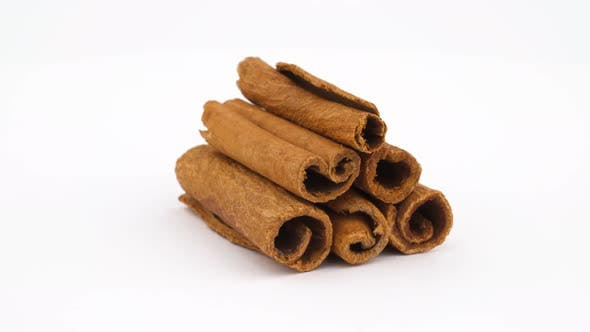 Thumbnail for Cinnamon Sticks Pile Rotating. Isolated on the White Background.