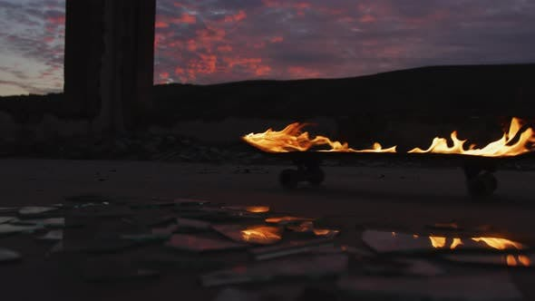 Thumbnail for Flaming skateboard reflected in broken glass