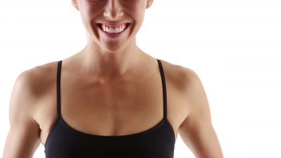 Thumbnail for Fit healthy mixed race woman measuring waist smiling