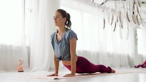 Woman Doing Upward-facing Dog Pose at Yoga Studio