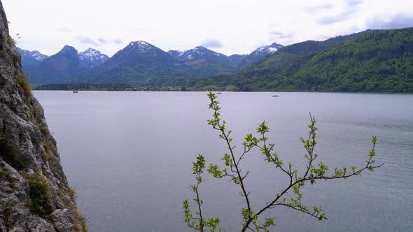 Thumbnail for Landscape View of a Mountain Lake, Cliffs and Snow-covered Mountain Peaks. Austria