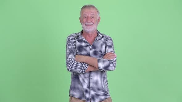 Thumbnail for Happy Senior Bearded Man Smiling with Arms Crossed